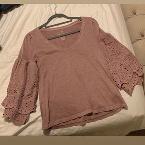 This eyelet sleeve blouse in lilac purple.